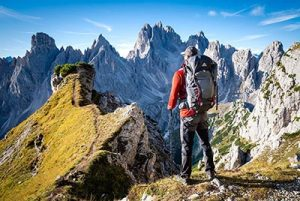 Male hiker on peak in mountains