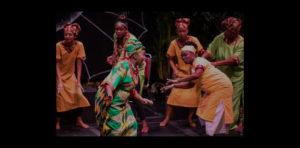 Women dancing in African attire