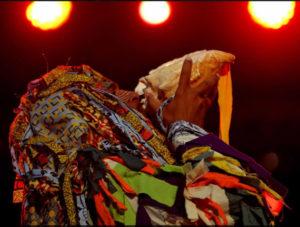 Pierrot blowing conch shell, Kambule, Carnival, Trinidad