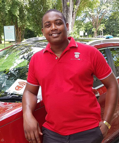 Driver from DeliverMe TT, Taxi Service Trinidad