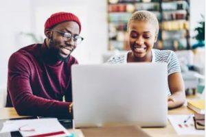 Black couple working on laptop