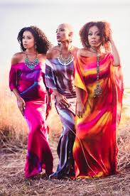3 young female models in hand dyed silk dresses