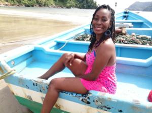 Woman sitting in pirogue boat at Maracas Beach Tour, Trinidad