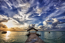 Jetty leading to covered hut at Pigeon Point beach Tobago