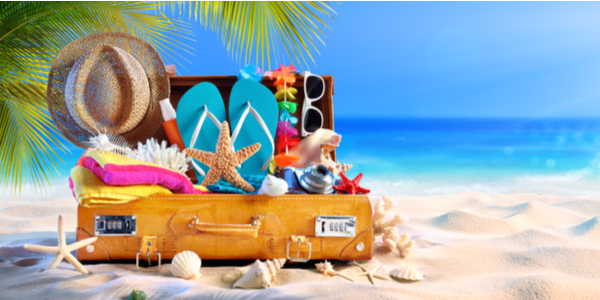 Fully packed suitcase with items for a Caribbean vacation