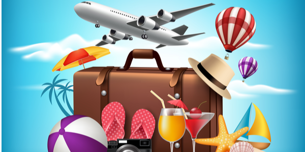 Suitcase with items that would be packed and used during a Caribbean vacation