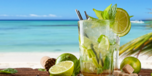 A Mojito drink with beach in background