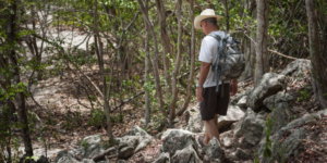 Man hiking on a trail in St. Jon