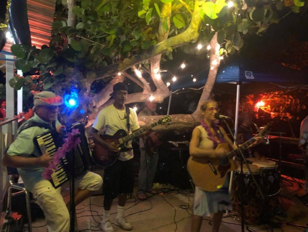 People singing and playing instruments at Lucy Bar at Open Mic night in St. John Caribbean